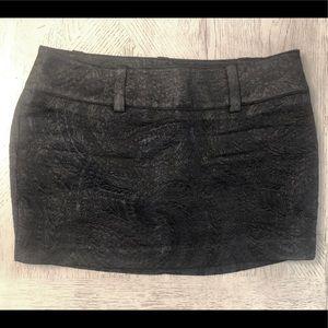 NWOT Black textured Bebe lined mini skirt. Sz 8